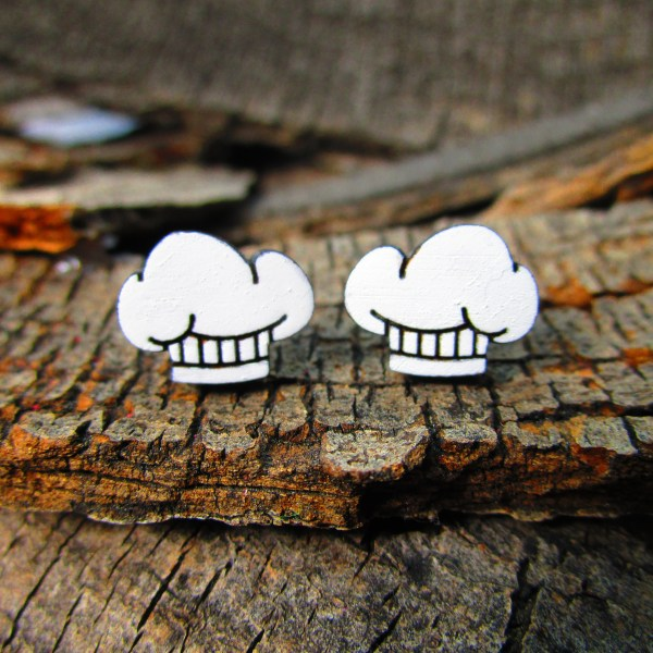 cute little chef hat stud earrings on wood background