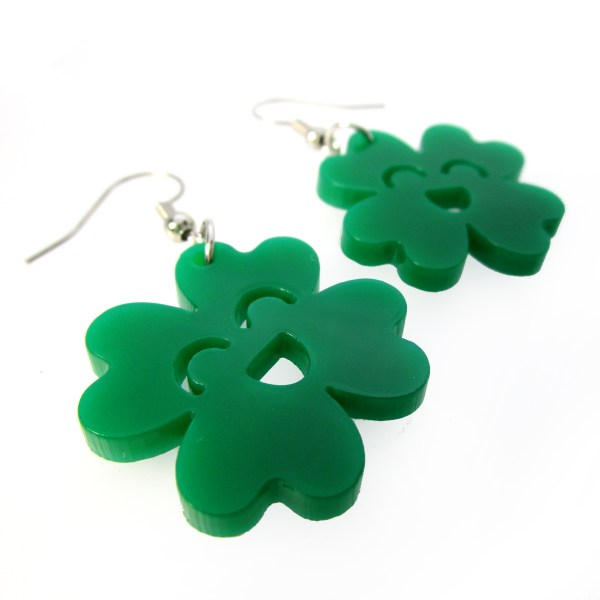 close up of green kawaii clover dangle earrings