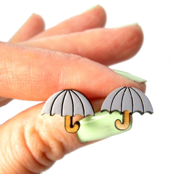 gray color umbrella earrings held by a hand to show size