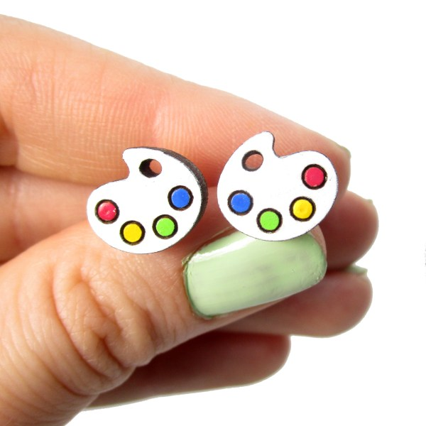 hand holding paint palet board earrings to show size