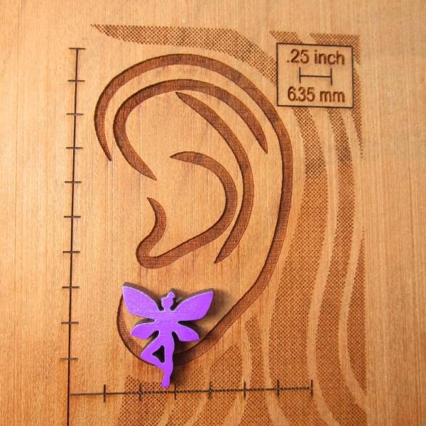 purple fairy earring on ear board to show size