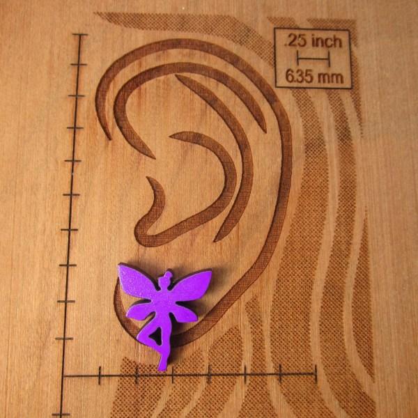 purple fairy pixie stud earring on size board