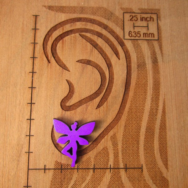 purple fairy pixie stud earring on size board