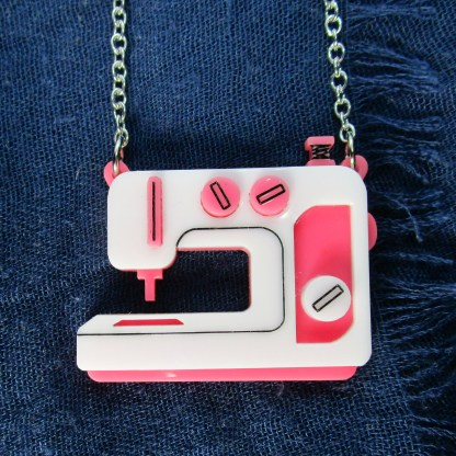 pink sewing machine pendant on blue cloth