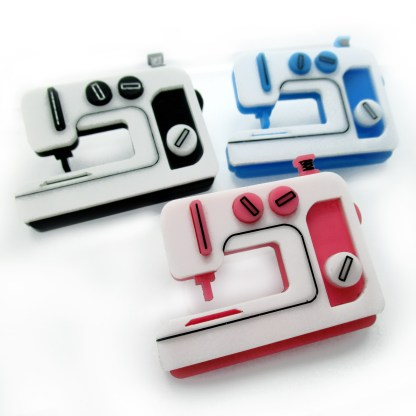 3 sewing machine brooches black pink and blue