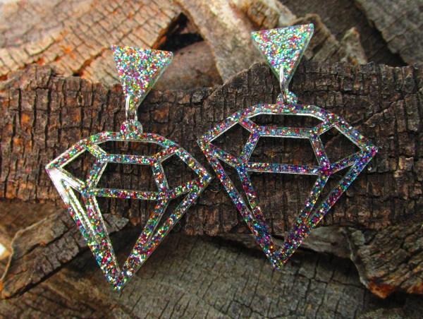 laser cut glitter diamond earrings on wood background