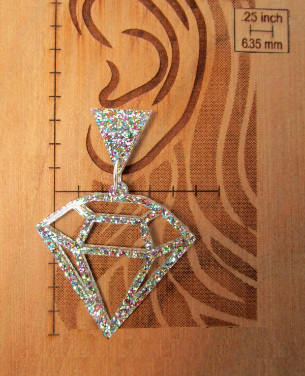 triangle and diamond shaped earring on diagram to show size