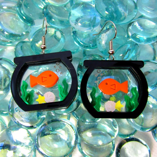 fish tank statement earrings on glass bubble background