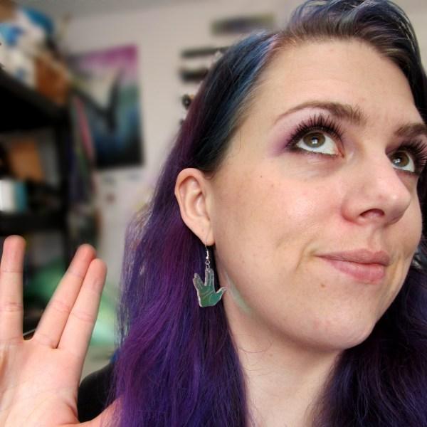 purple hair lady wearing spock vulcan hand earrings