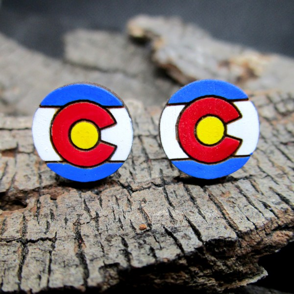 colorado flag hand painted laser cut wood stud earrings on wood background