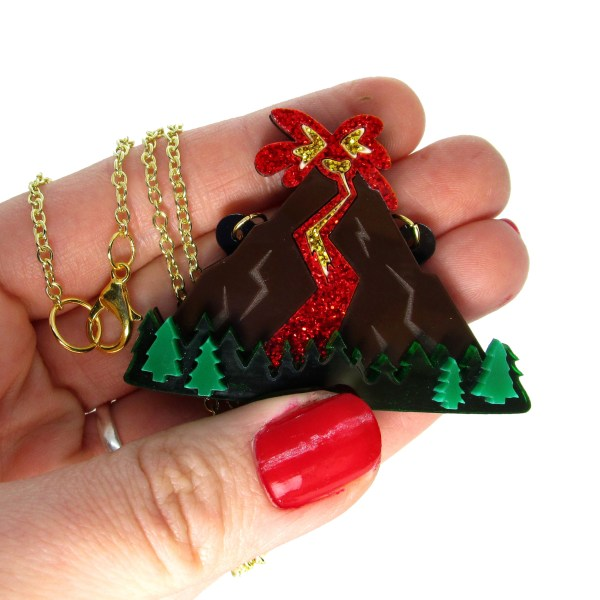 hand holding volcano necklace to show size
