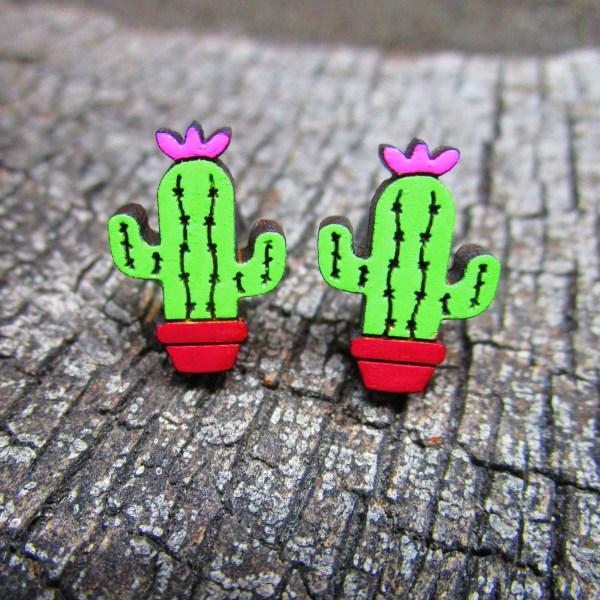 little saguaro painted wood stud earrings on wood background