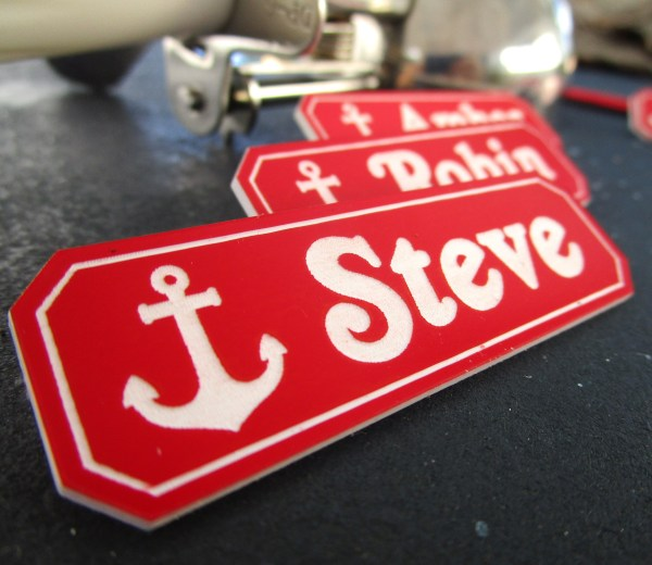up close detail of steve name tag from scoops ahoy with anchor image