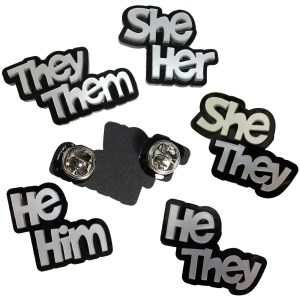 they them she her he him he they she they pin back brooches in silver color lettering pronoun display badge