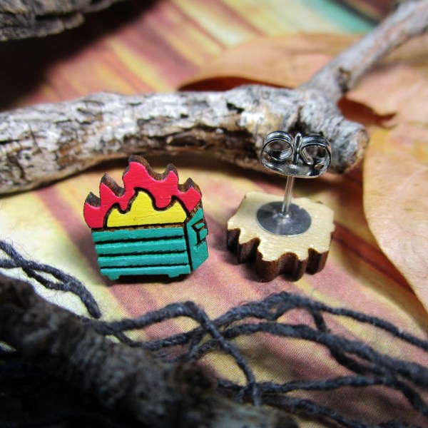stud earrings of little green dumpsters on fire