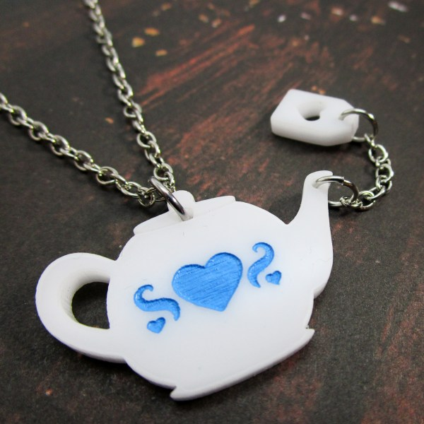 Teapot charm necklace with heart teabag tag pouring motion white teapot with blue heart engraving pendant necklace