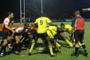 THE SCRUM: Mens res and MGI tackle each other in the scrum.