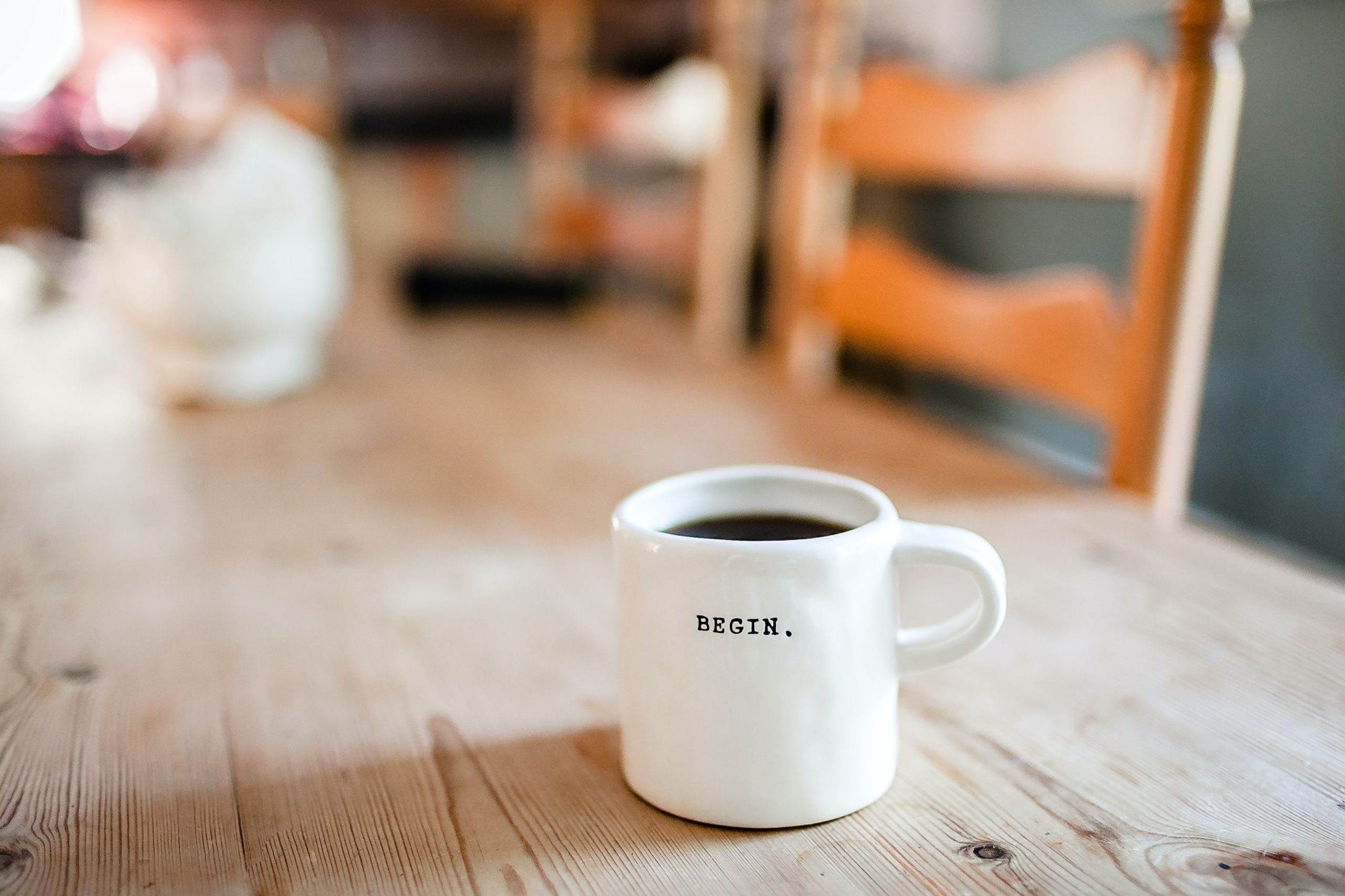 A coffee cup on a desk showing work to be done.