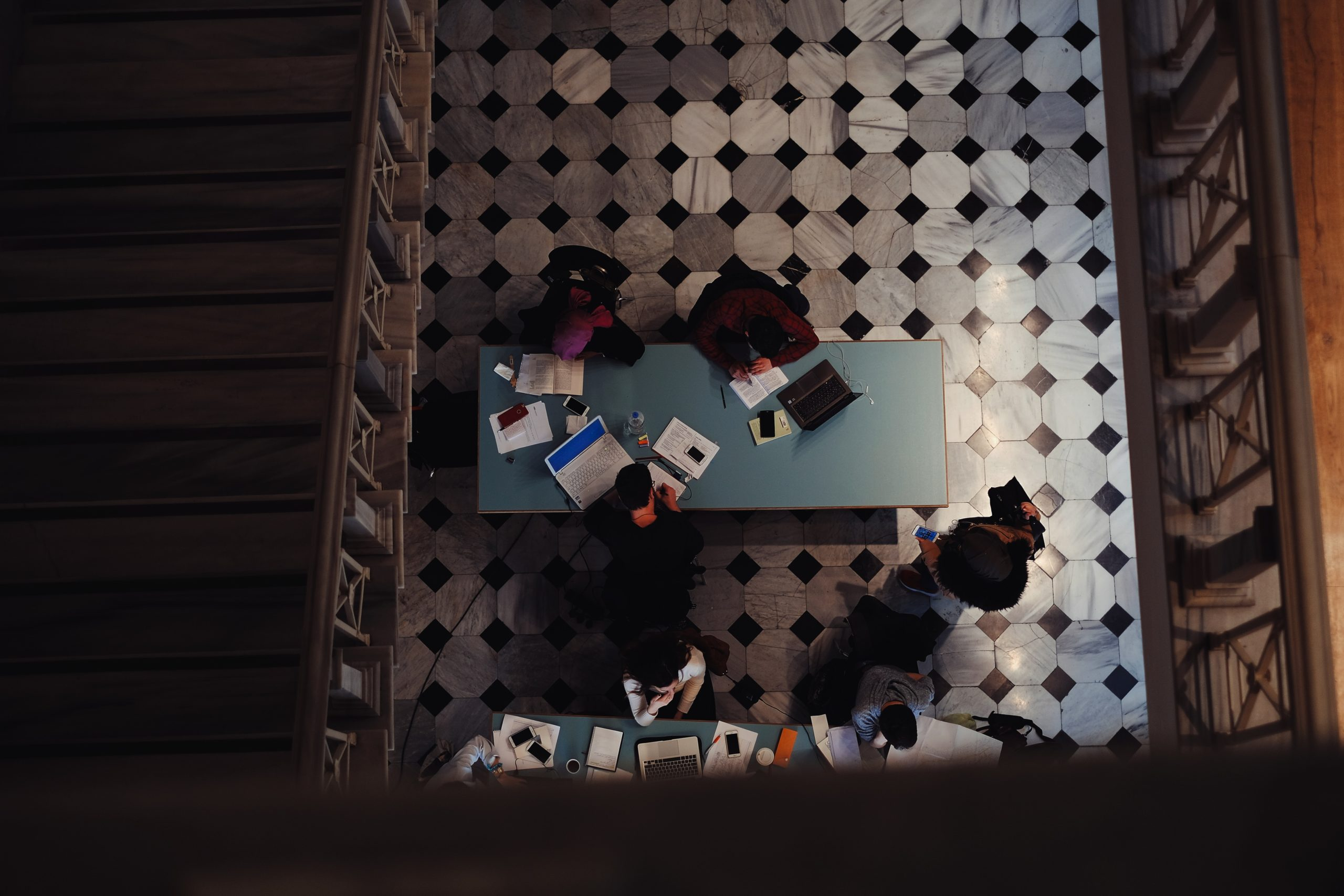 Students sitting at a table working.