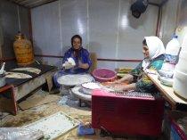 Women preparing delicious pita