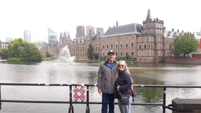 A man and a woman stand in front of a castle in the Hague
