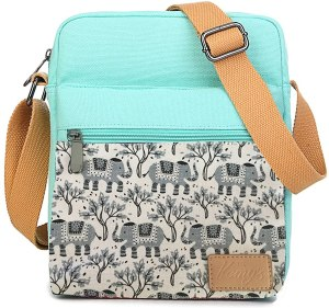 Light blue crossbody bag, made of canvas with a wide comfortable strap.