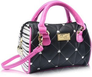 a cute small Betsey Johnson tote purse with top handle, removable strap.