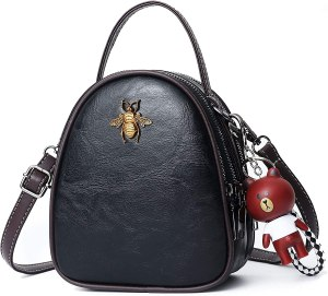 little crossbody bag for teens having dark black color, thin top handle and crossbody straps.