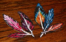 And lastly some beautiful hand painted fabric feathers, these were just a little doodle in acrylic on some fabric scraps to fill some time when my big monkey was painting, but the turned out so cute I finished them with some spray varnish and now I'm wondering what to do with them...