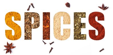 The word spices with mix of spices over white