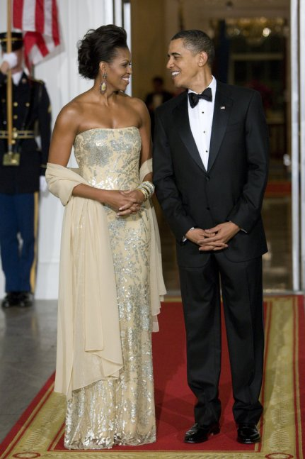 """U.S. President Barack Obama and first lady Michelle Obama await the arrival of India's Prime Minister Manmohan Singh and his wife Gursharan Kaur for a state dinner on the North Portico of the White House. "" (Photo by Brooks Kraft LLC/Corbis via Getty Images)"
