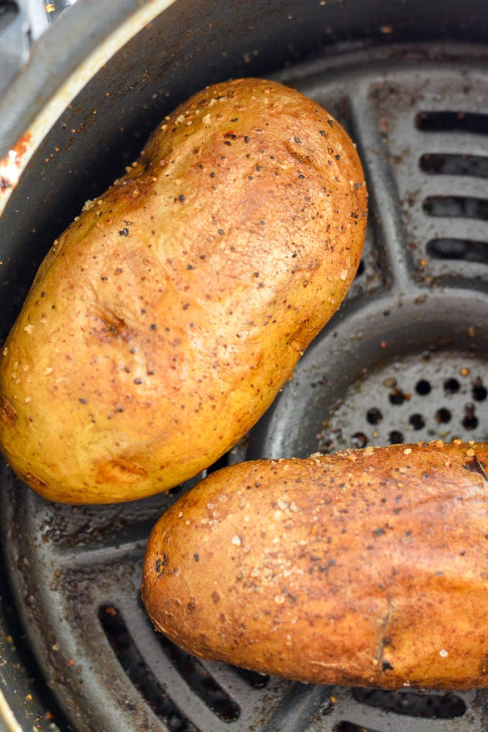 Air Fryer Baked Potatoes have a super crispy outside, soft, fluffy & tender inside and only take 40 minutes.