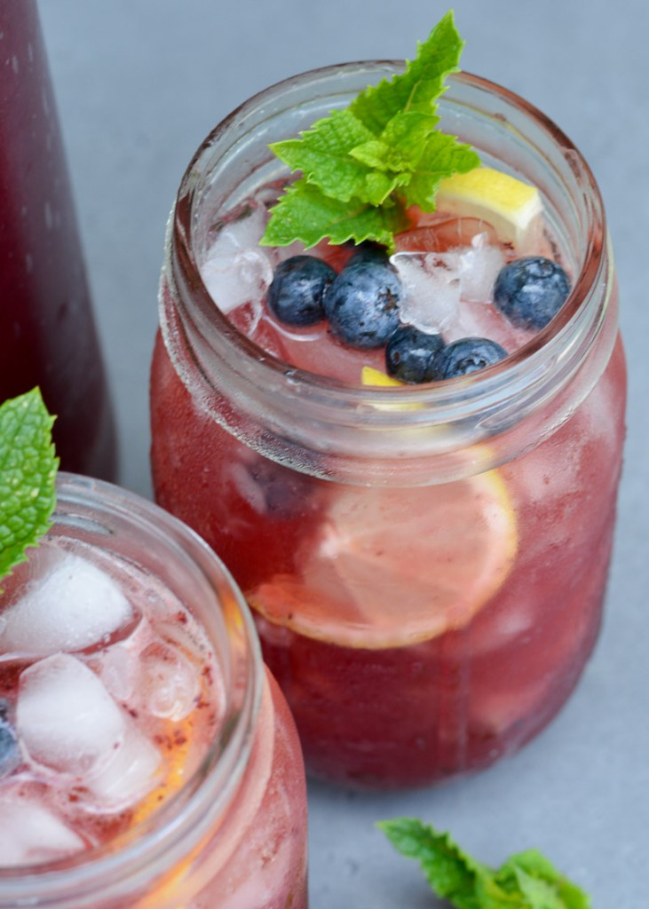 This refreshing Spiked Blueberry Lemonade recipe is perfect for your summer parties! You only need 5 ingredients and 20 minutes for this adults-only treat!