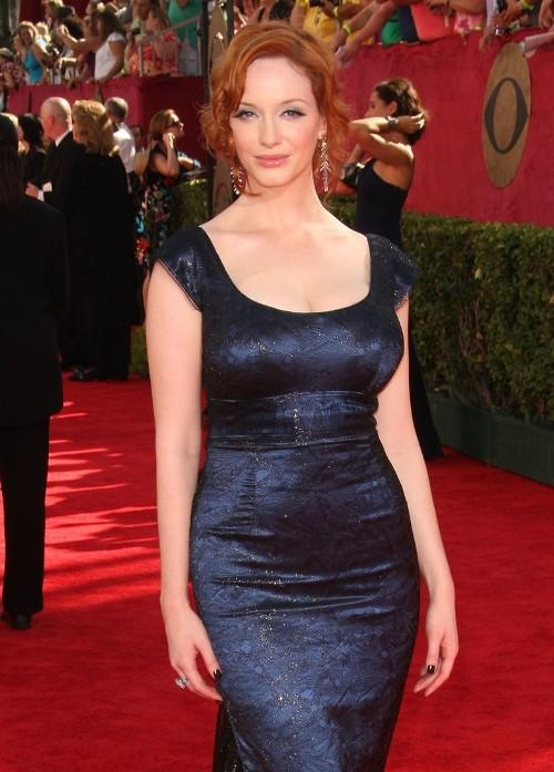 Christina Hendricks in L'wren Scott dress, Fred Leighton jewels and Prada clutch and shoes.
