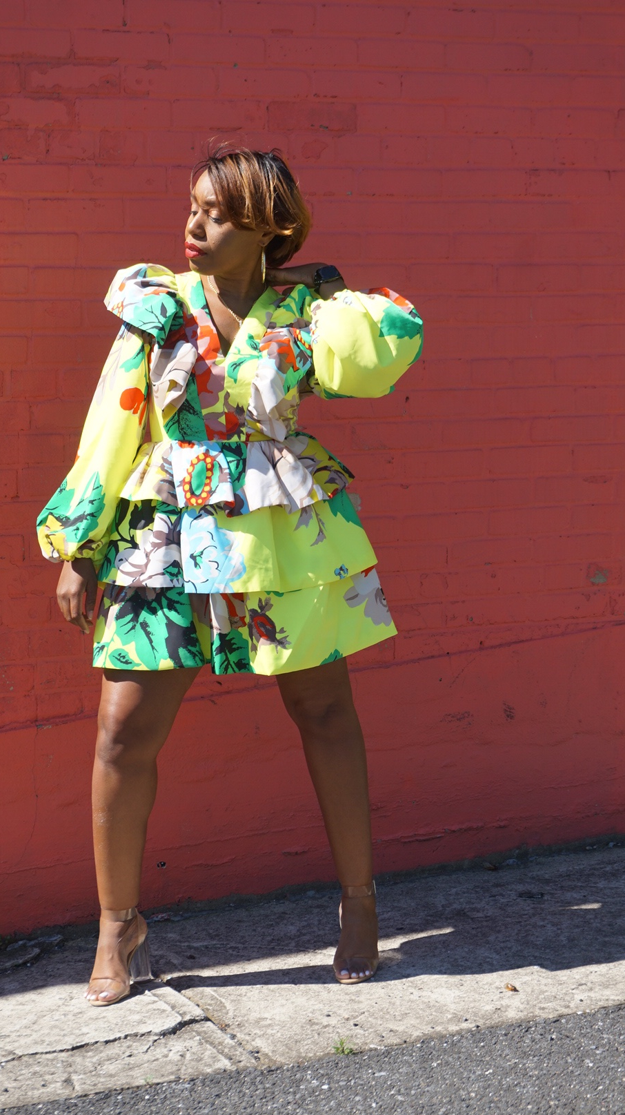 woman posing and wearing colorful dress