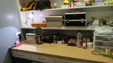 My 'vanity' table. Here you can see my boxes that hold my skincare supplies and my makeup box and brushes.