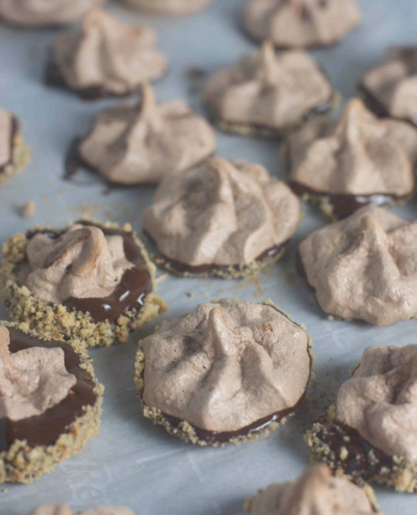 Chocolate hazelnut meringue cookies are simpler than you'd think, have just right amount of crunch, and taste like nutella. Cookies don't get any better!