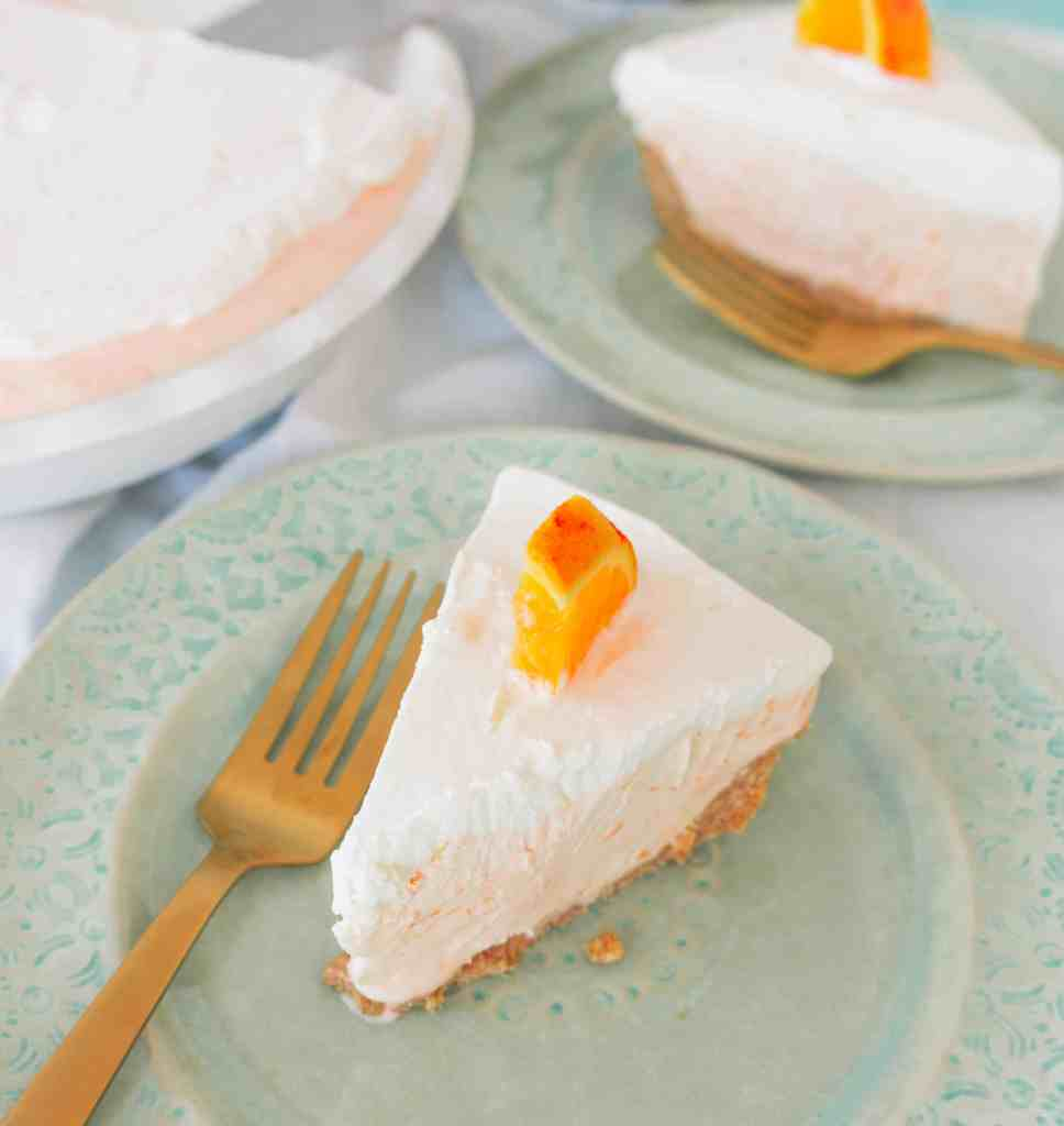 This easy fuzzy navel ice cream pie is light and summer-y, and best of all, quick to put together and a totally no bake dessert!