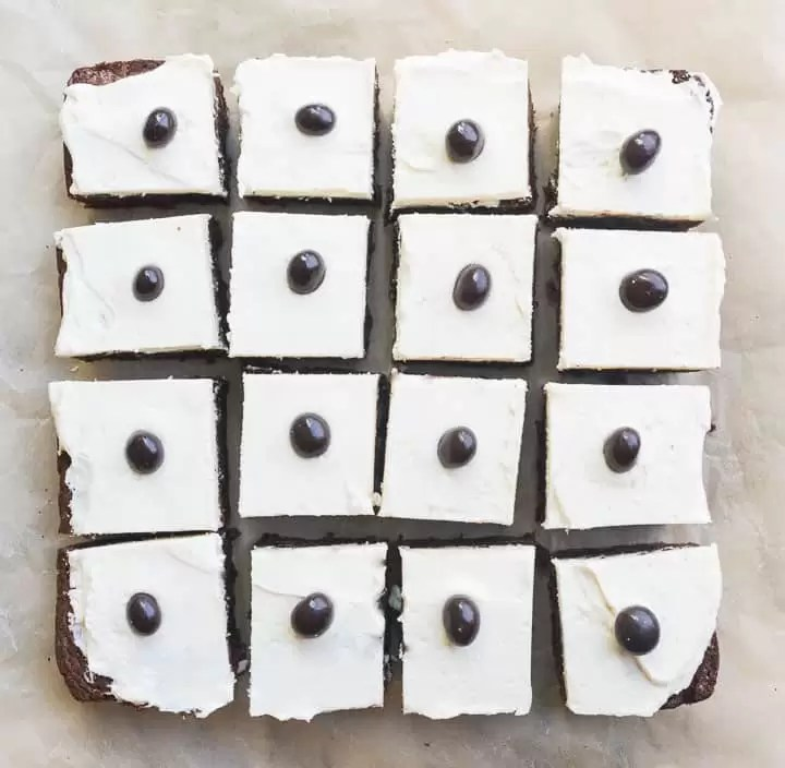Overhead view of a batch of frosted Irish cream espresso bean brownies after they've been sliced