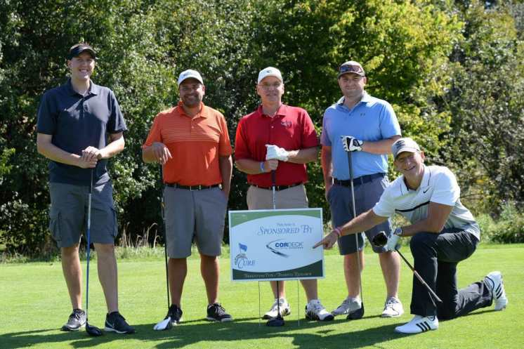 Cordeck foursome golfing at Tee Up Fore the Cure 2017