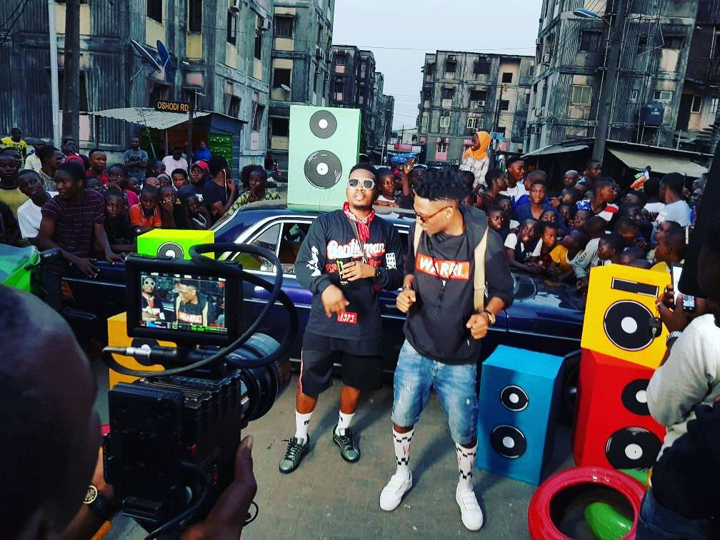 "BTS Photos: Efe & Olamide hit the streets to shoot Video for ""Warri"""