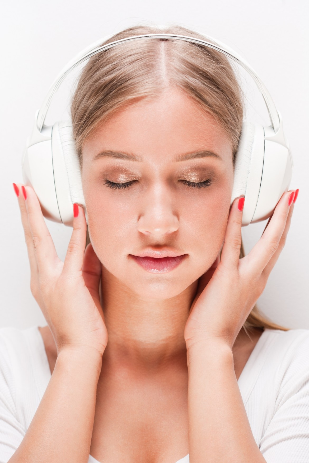 A person listening to calming music from their headphones.