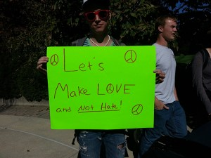 One of many signs students made to hold up during the impromptu counter-protest.