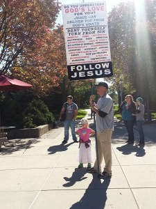 Steve stood quietly with his sign for most of the day, alongside his young daughter.