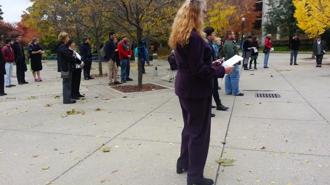 A steady crowd was present throughout the read-in, with students, faculty, staff and the community stopping to listen. Preface photo/SARAH DUIS