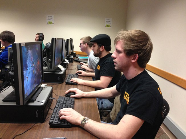 (Front to back) League of Legends at IUSB club members Chance Starcher, Eric Walerko and Andrew Matthews meet every Wednesday in the basement computer lab of Northside Hall room NS0038. (Preface photo/GEOFF LESAR)