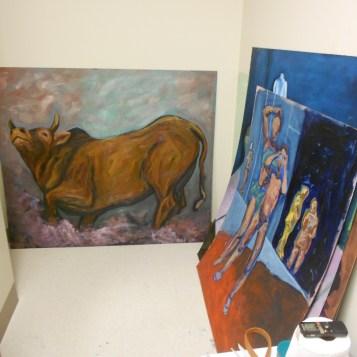Paintings line the walls of Katherin Corpe's private BFA studio. (Photo/Melissa Seyboldt)