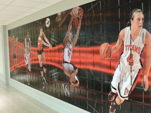 A mural in the SAC may be added to in order to include three new sports. (Preface photo/ Neil King)