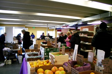 Shoppers talk to vendors at the new Purple Porch marketplace. (Preface photo/Izza Jatala)