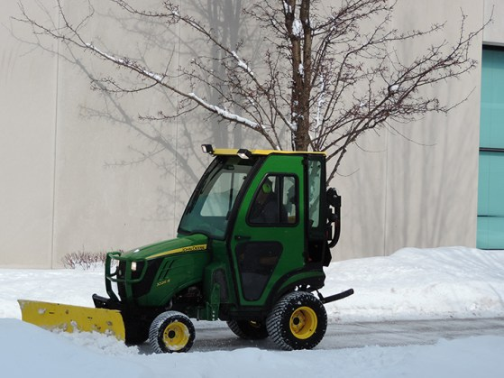 A groundskeeper plows snow from a sidewalk after a snow. (Preface Photo/NEIL KING)